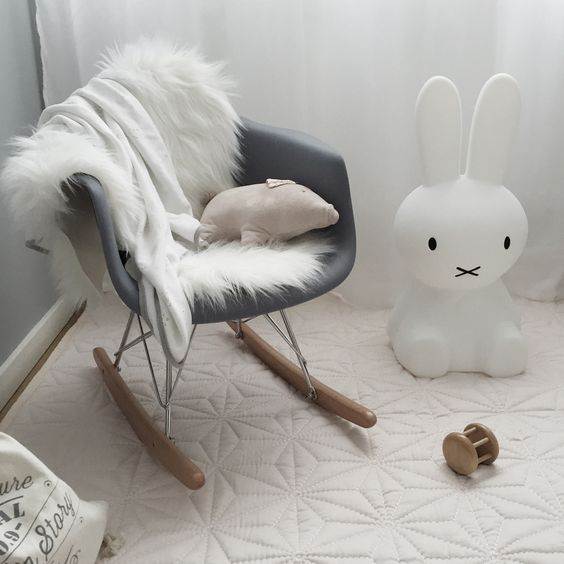 this is what I want in our nursery one day. Eames rocking chair and that lil bunny there! :)