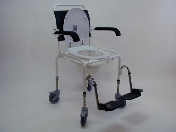 Over the toilet shower and commode chair with a normal toilet seat