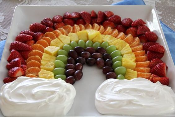 """St. Patrick's Day~Fruit rainbow. Instead of fruit dip, you can also substitute gold foil wrapped chocolate coins/candy for the """"Pot 'O Gold"""" at one end of the rainbow."""