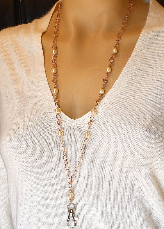 Stunning rose gold, pearl, and crystal over-the-head chain lanyard with silver swivel clip. The flat oval cable links are patterned to look