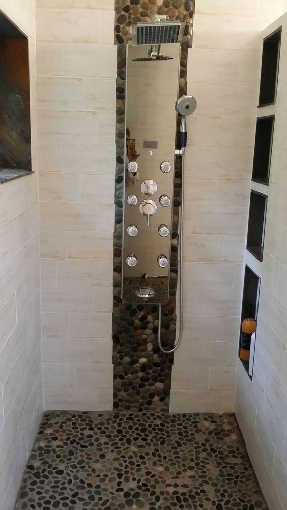 River rock, slate, porcelain barn wood. Master bath shower.