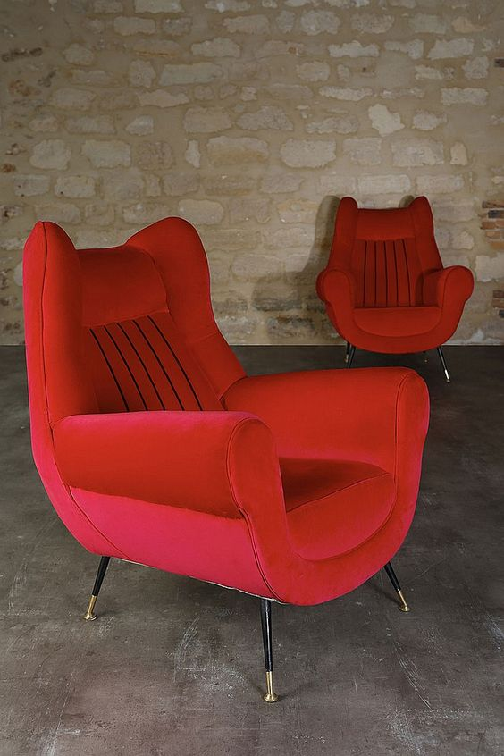 Red covered armchairs: red velvet, black piping and golden brass foot pad steel, circa 1952 - by FauveParis