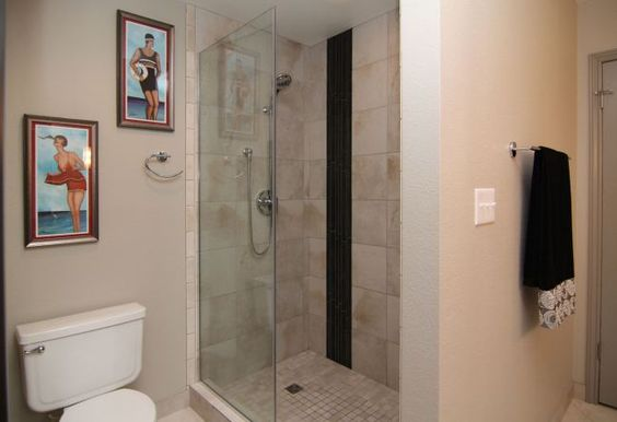 The tub was replaced with this beautifully large shower with frameless glass enclosure.