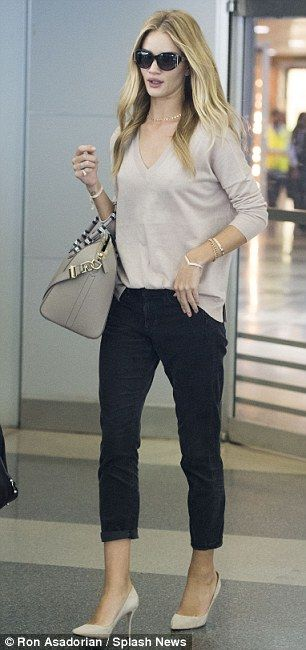 Travelling in style: Rosie jetted out of LA on Sunday and looked chic in beige and blue as...