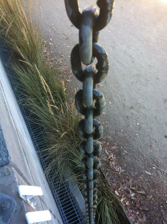 Instead Of An Unseemly Drainpipe A Heavy Chain Draws