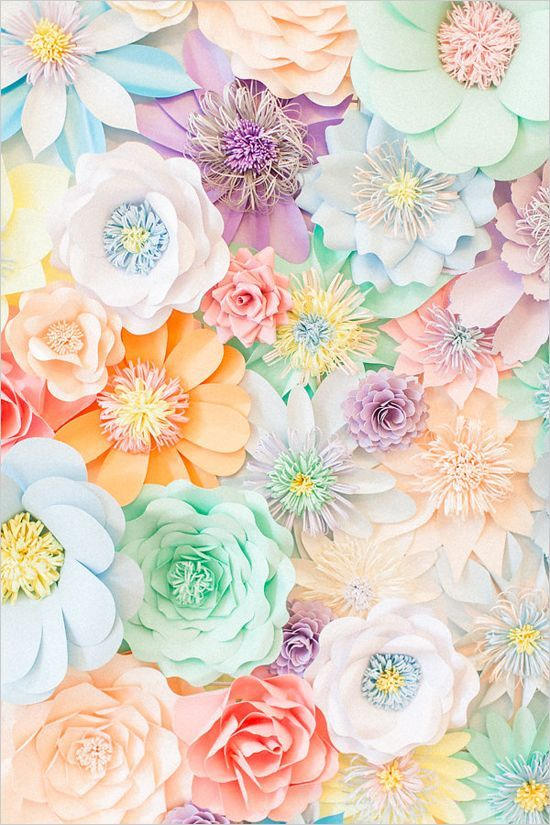 Paper flower backdrop for an engagement party or bridal shower.