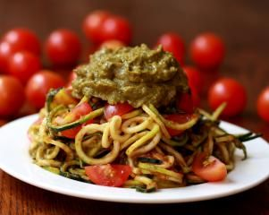TOMATO ZUCCHINI PASTA WITH AVOCADO BASIL PESTO.    October 15th, 2011    The raw dish is incredibly tasty and also very good for you while being low in calories.    Ingredients.  For the pasta  1 kg of zucchini (small if you have a vegetable pasta cutter or large if you are making strips with a vegetable peeler)  8 sun-dried tomatoes  1 cup water  1 teaspoon olive oil  1 teaspoon red wine vinegar  Salt  Cherry tomatoes to serve  For the pesto  1 bunch basil  1 avocado  1 clove of garlic  1…