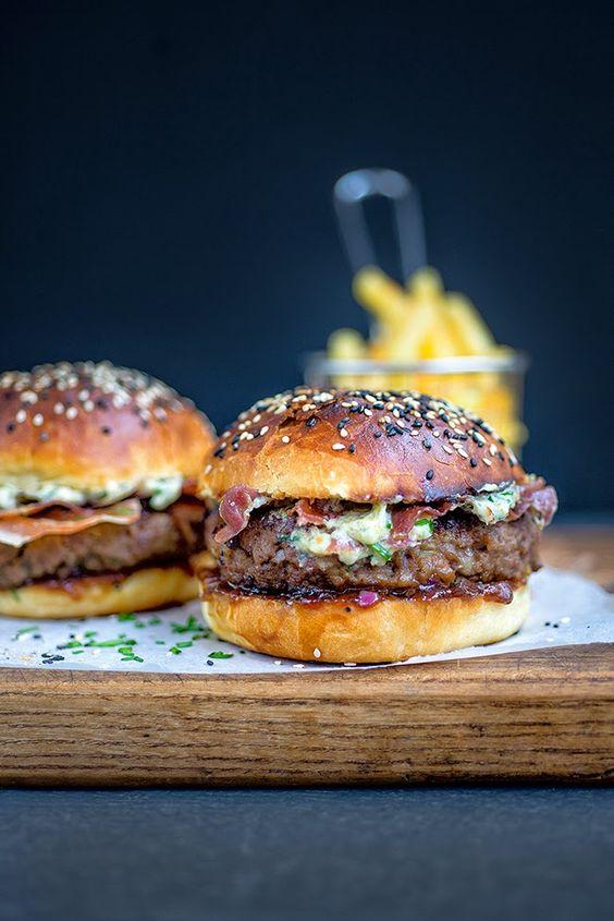 Blue cheese burgers on light brioche rolls with crispy pancetta and onion chutney