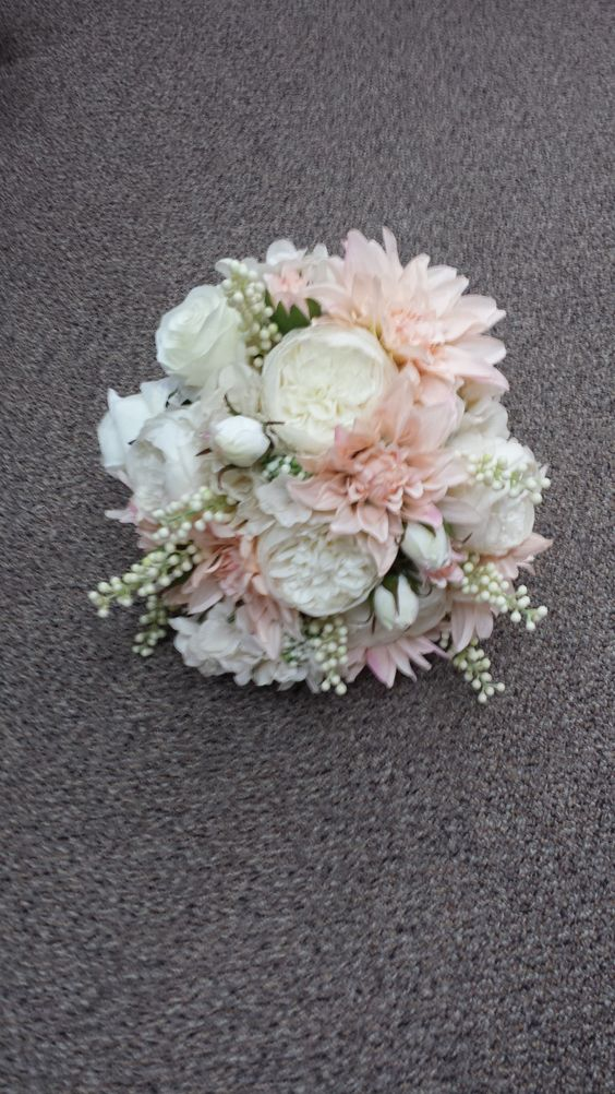 Peach and Cream Silk Wedding Bouquet. from: Gallery Florist and Gifts in Mebane, NC www.galleryfloristandgifts.com.