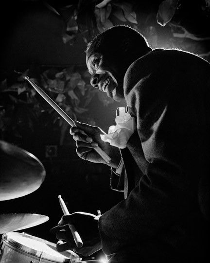 Herman Leonard photo of Kenny Clarke, one of the originators of bebop, moved to Europe and became an iconic jazz drummer.