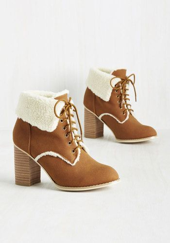 You'll be so excited to receive these caramel brown booties from Banned that you'll just have to them hug! What a pleasure it will be, too, because the folded ankles, shearling-inspired lining, and super-soft faux suede of these stacked heels are a delight both in your arms and on your feet.