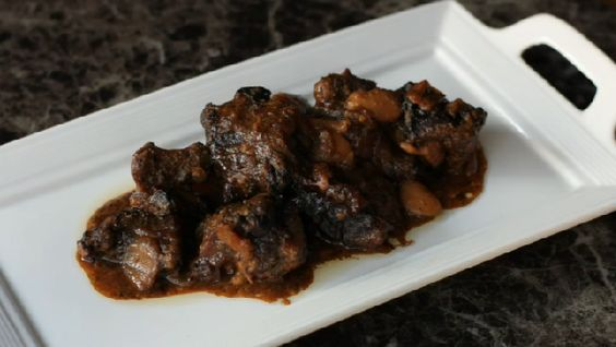 Video: How to Make Jamaican Oxtail With Rice