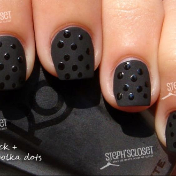 Black matte nail polish with Polka dot design