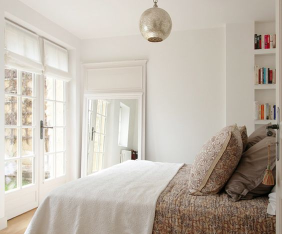 A serene and neutral bedroom with walls painted Farrow and Ball in Wimborne White.  Come learn about the 12 Best Calm Paint Colors {Top Picks from Designers!} #wimbornewhite #neutralinterior #bedroomdecor