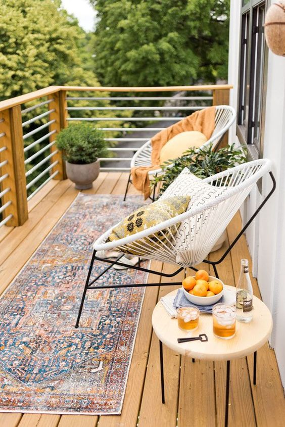A balcony makeover perfect for summer entertaining or just reading a book. Click through for the full reveal and learn how to add privacy outdoors on a budget. #summer #outdoorspace #modernoutdoorspace