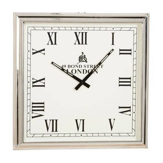 "Nickel Square Wall Clock Dimension:22.5""w x 22.5""h Item# 412275. Ethan Allen US. Lovers of transitional design will take a shine to this contempo-classic timepiece. A square frame of brightly polished nickel-plated steel holds a white face adorned with black Roman numerals. Its accurate quartz movement runs on an AA battery."