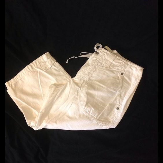 White capri shorts White shorts have ties on waist and snaps on back pockets.  Snaps on bottom cuffs for adjusting width.  Waist 30 inches.  Inseam 16 inches.  Gloria Vanderbilt brand. Gloria Vanderbilt Shorts Bermudas