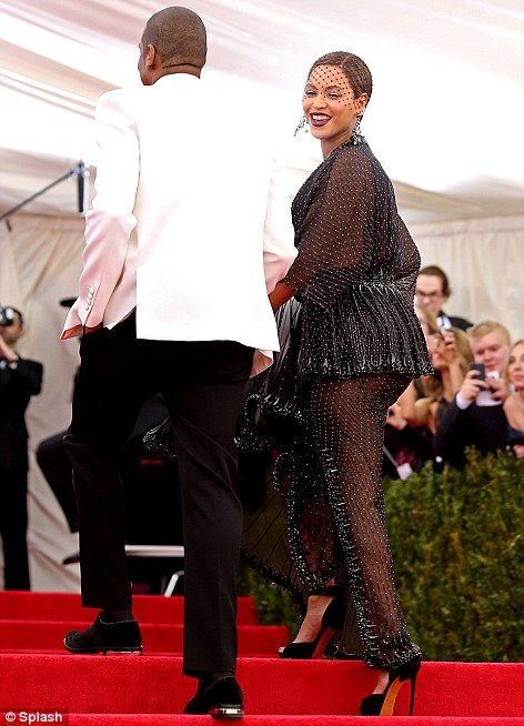 Drunk in love: Beyonce looked amazing in her low-cut beaded Givenchy couture dress and vei...