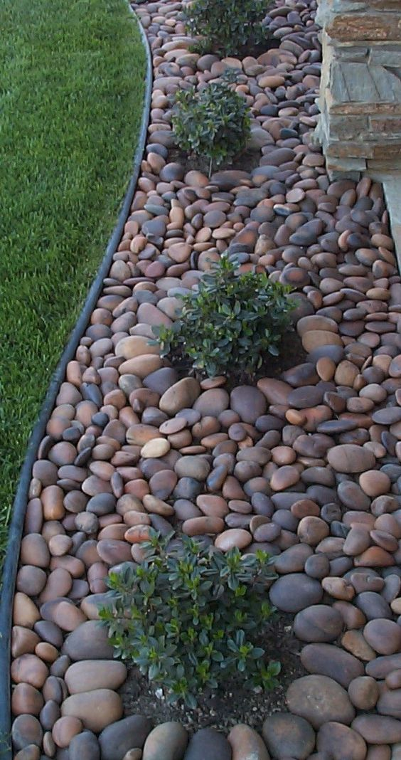 River rock instead of mulch in a small courtyard area.