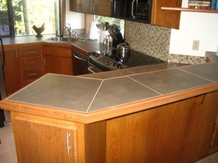 Kitchen remodel after new tile countertop installation.