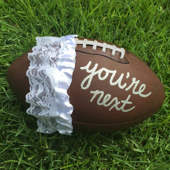 """For a fun #WeddingWednesday twist on the classic """"garter toss"""", decorate a football with one of our Gold & Silver Markers and watch the competition heat up!"""