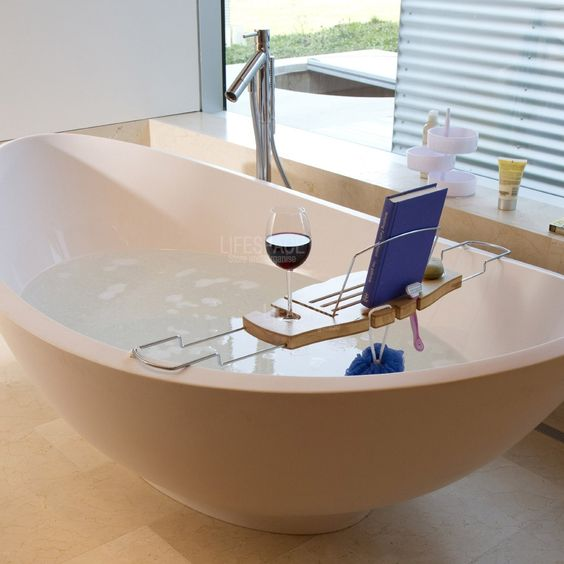 The ultimate accessory for rest and relaxation. Made from bamboo, a highly renewable resource, this expandable bathtub caddy has a built in wine glass holder and fold away book support. Product Features: Expands to fit bath Holds soap, wine glass and book Made from treated bamboo Dimensions:H30mm x W710 - 1000mm x D220mm