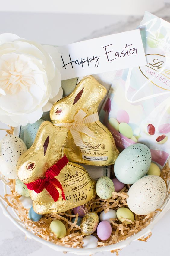 This year create a classic Easter Basket with  Easter treats for kids like Lindt chocolate! Layer paper grass and speckled Easter eggs as the base of your DIY Easter Basket. Then add your favorite chocolate like Lindt GOLD BUNNY figures, and chocolate LINDOR eggs. Finally, add unique details like a paper flower and a calligraphy tag to give the basket a finished look! Find more Easter Lindtspiration on the Lindt Chocolate Blog! #Sponsored #MyLindtEasterBasket #LindtPartner