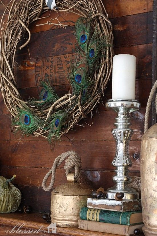 Peacock feather wreath / part of Layered Glam Fall Mantel by My Blessed Life, featured on http://www.funkyjunkinteriors.net/: