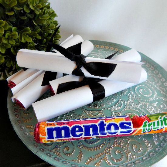 Menos DIY Graduation Favors - Simple and easy.  Mentos, white copy paper, and ribbon.