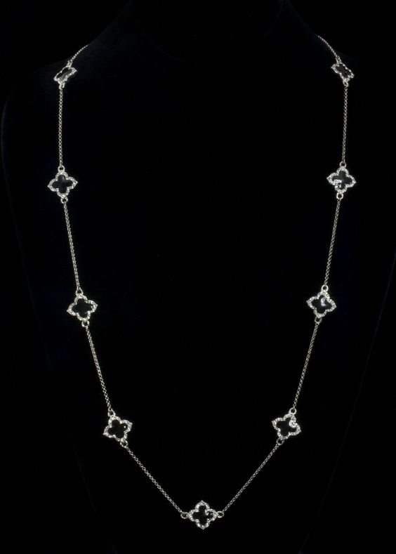 """Rhodium Onyx Cz Necklace  Rhodium plated chain with black onyx enamel surrounded with sparkling cz's. Necklace is a long 58"""""""" with lobster claw clasp. Necklace is long enough to wrap around several times for a layered look.   http://www.sterlingjewelrystores.com/product660.html"""
