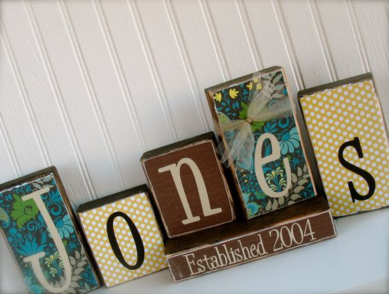 modge podge scrapbook paper on blocks add family name or anything else!! ♥