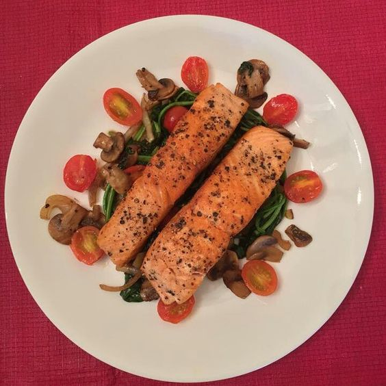 Pan-seared salmon with mushroom, spinach and grape tomato