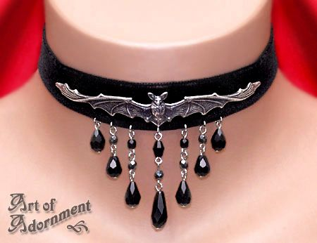 """Adjustable from 12"""" up to 15"""" neck size. 7/8"""" wide black Swiss velvet ribbon band, with an antiqued silver-plated brass stamping of a vampire bat which measures about 4 3/4"""" (12cm) long, which is gently curved to fit the contour of the neck. A shower gunmetal """"hematite"""" grey Czech glass beads suspend 7 black Austrian crystal teardrops. The clasp and adjustment chain are silver-tone"""