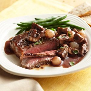 Beef with Mushrooms and Pearl Onions in Red Wine Reduction: Tender beef pairs delightfully with mushrooms in a decadent red wine sauce. With only 9 grams of carb per serving, this main-dish recipe is elegant and easy.