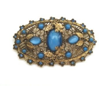 love the color of the moonstone on this.  ~Vintage Czech Art Nouveau Gilded Blue Glass Moonstone Brooch Pin Florals Vines