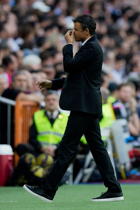 Head coach Luis Enrique Martinez of FC Barcelona leaves the pitch during the La Liga match between Real Madrid CF and FC Barcelona at Estadio Santiago Bernabeu on October 25, 2014 in Madrid, Spain.