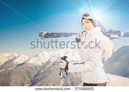 Ski. Happy female skier on the background of high snow-capped Alps in Swiss. Healthy lifestyle and outdoor activity