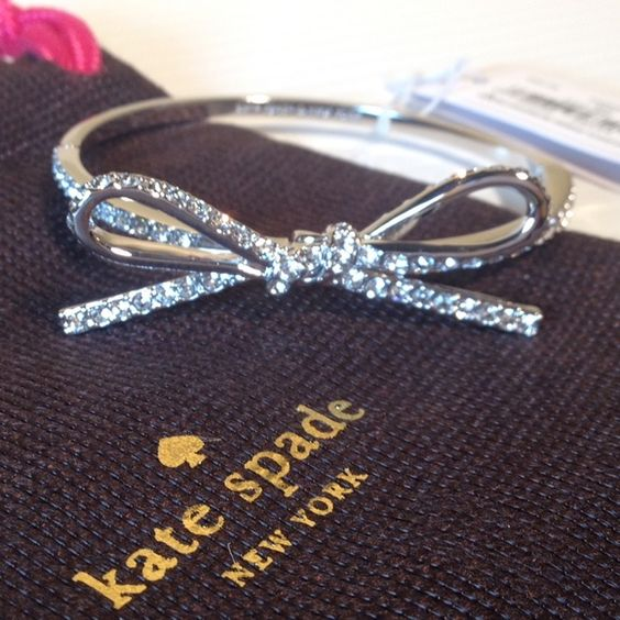 """SALE!❤️NWT Kate Spade Skinny Pave Bow Bracelet New with tags. Silver. Comes with Kate Spade dustbag as shown.  Measures a diameter of 2.25"""".  Matching Kate Spade pave bow earrings also available!  NO TRADES kate spade Jewelry Bracelets"""
