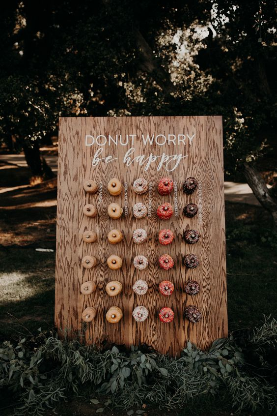 Adorable wooden donut wall at this modern California wedding | Image by Emily Magers