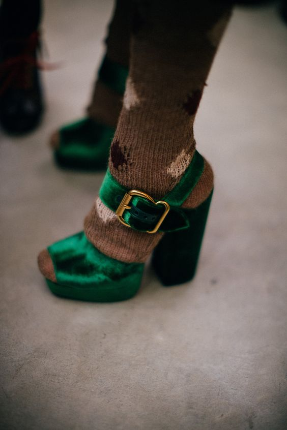 Green crushed velvet buckle shoes backstage at Prada: