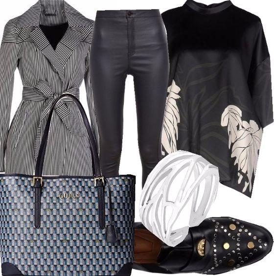 Il nero...lo scuro con un gioco di righe e quadri. La similpelle dei pantaloni e le borchie danno quel tocco tutto rock a un look sofisticato e fresco.