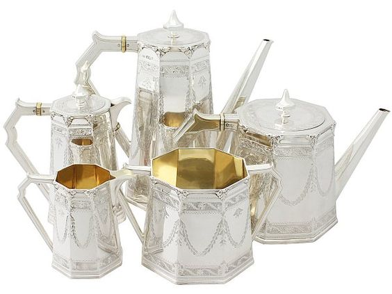 'Victorian Tea Service' An exceptional, fine and impressive, unusual antique Victorian English sterling silver five piece tea and coffee service.