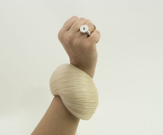 PONY 'A4M6' ring with a screw thread, silver 925 and PONY bracelet, horse hair and various materials, Annea Lounatvuori 2015, picture Janne Lounatvuori - Annea Lounatvuori's pieces are an extension of her work from last year. In Time Perception Vol.II she delves deeper into her passion of working with horse hair. Textures and surfaces determine her approach to the visual composition.: