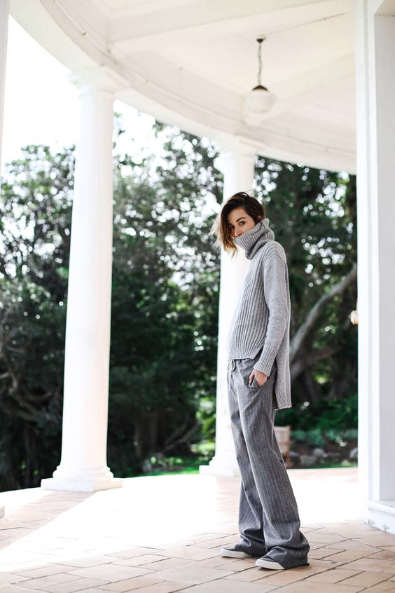 Carmen Hamilton in a tomboy style inspired outfit, oversized turtleneck sweater and pinstripe ash grey trousersSweater: Country Road