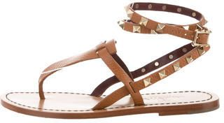 Tan leather Valentino Rockstud sandals with gold-tone stud accents, stacked block heels and buckle closures at ankle straps.