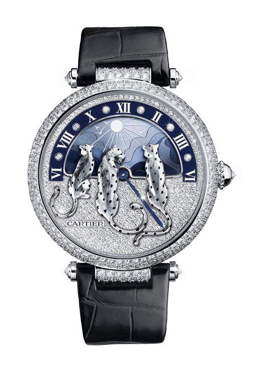 La montre Rêves de Panthères signée Cartier http://www.vogue.fr/joaillerie/le-bijou-du-jour/diaporama/la-montre-reves-de-pantheres-jour-nuit-signee-cartier-sihh-2015/21802:
