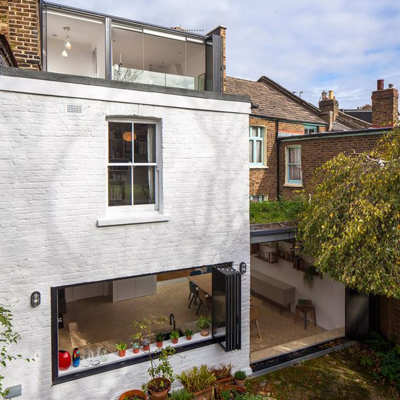 London house remodelled by Studio 30 with loft bedroom and courtyard-inspired kitchen