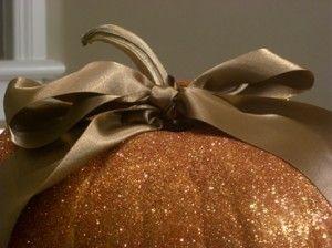 glitter pumpkins with ribbon.