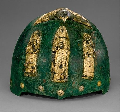 Elamite Helmet with divine figures beneath a bird with outstretched wings.    Middle Elamite (c.1500-1100 BC)    South West Iran