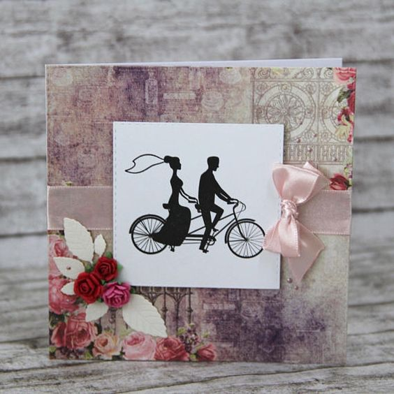 Wedding card pair on bycicle